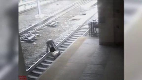 Caught on Camera: NJ cop pulls man off train tracks with seconds to spare